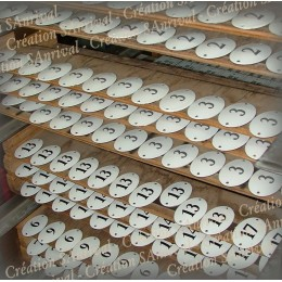 Oval numbers enamelled and silk-screened awaiting cooking